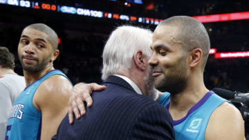 SAN ANTONIO, TX - JANUARY 14: Former San Antonio Spurs player Tony Parker #9 of the Charlotte Hornets greets his former head coach, Gregg Popvich of the San Antonio Spurs at the end of the game at AT&T Center on January 14, 2019 in San Antonio, Texas. NOTE TO USER: User expressly acknowledges and agrees that , by downloading and or using this photograph, User is consenting to the terms and conditions of the Getty Images License Agreement. (Photo by Ronald Cortes/Getty Images)