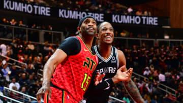 Vince Carter of the Atlanta Hawks and DeMar DeRozan of the San Antonio Spurs.(Photo by Scott Cunningham/NBAE via Getty Images)