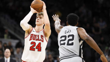 Dec 15, 2018; San Antonio, TX, USA; Chicago Bulls power forward Lauri Markkanen (24) shoots the ball over San Antonio Spurs small forward Rudy Gay (22) during the first half at AT&T Center. (Soobum Im-USA TODAY Sports)