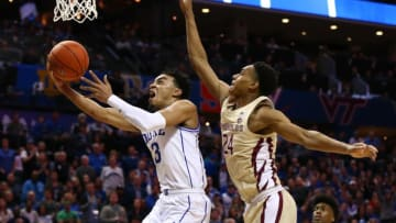 Mar 16, 2019; Charlotte, NC, USA; Duke Blue Devils guard Tre Jones (3) shoots the ball against Florida State Seminoles guard Devin Vassell (24) in the second half in the ACC conference tournament at Spectrum Center. Mandatory Credit: Jeremy Brevard-USA TODAY Sports
