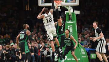 Mar 24, 2019; Boston, MA, USA; San Antonio Spurs center LaMarcus Aldridge (12) shoots the ball over Boston Celtics forward Guerschon Yabusele (30) during the second half at TD Garden. Mandatory Credit: Bob DeChiara-USA TODAY Sports