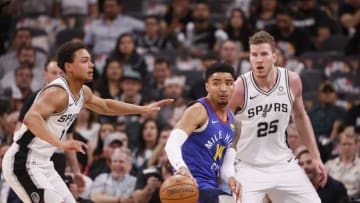 Apr 25, 2019; San Antonio, TX, USA; Denver Nuggets shooting guard Gary Harris (14) moves the ball against the defense of San Antonio Spurs shooting guard Bryn Forbes (left) and Jakob Poeltl (25) at AT&T Center. (Soobum Im-USA TODAY Sports)