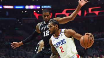 Feb 3, 2020; Los Angeles, California, USA; Los Angeles Clippers forward Kawhi Leonard (2) drives to the basket against San Antonio Spurs forward LaMarcus Aldridge (12) in the first half at Staples Center. Mandatory Credit: Jayne Kamin-Oncea-USA TODAY Sports