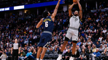 Feb 10, 2020; Denver, Colorado, USA; San Antonio Spurs forward Rudy Gay (22) attempts a shot against Denver Nuggets forward Keita Bates-Diop (6) in the second quarter at the Pepsi Center. Mandatory Credit: Isaiah J. Downing-USA TODAY Sports