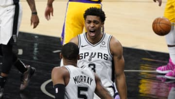 Dec 30, 2020; San Antonio, Texas, USA; San Antonio Spurs guard Keldon Johnson (3) reacts with guard Dejounte Murray (5) in the first quarter against the Los Angeles Lakers at AT&T Center. Mandatory Credit: Scott Wachter-USA TODAY Sports