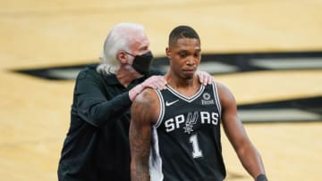 Apr 16, 2021; San Antonio, Texas, USA; San Antonio Spurs head coach Gregg Popovich grabs guard Lonnie Walker IV (1) by the shoulders in the second half against the Portland Trail Blazers at the AT&T Center. Mandatory Credit: Daniel Dunn-USA TODAY Sports