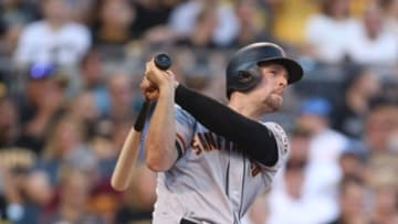 Jun 21, 2016; Pittsburgh, PA, USA; San Francisco Giants third baseman Conor Gillaspie (21) hits a two run home run against the Pittsburgh Pirates during the fourth inning at PNC Park. Mandatory Credit: Charles LeClaire-USA TODAY Sports