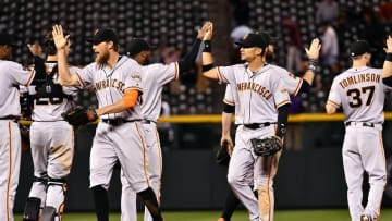 Sep 6, 2016; Denver, CO, USA; Members of the San Francisco Giants celebrate the win over the Colorado Rockies at Coors Field. The Giants defeated the Rockies 3-2. Mandatory Credit: Ron Chenoy-USA TODAY Sports