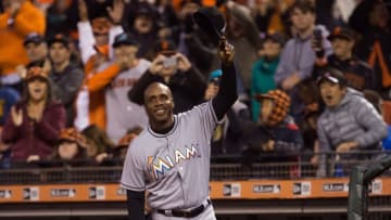 Apr 22, 2016; San Francisco, CA, USA; Miami Marlins hitting coach Barry Bonds (25) acknowledges fans as a video montage of his time as a San Francisco Giants player plays on the video board during the third inning at AT&T Park. Mandatory Credit: Kelley L Cox-USA TODAY Sports