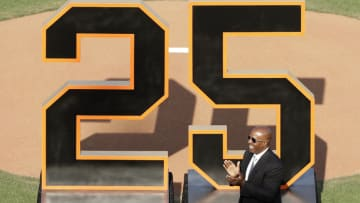 SAN FRANCISCO, CA - AUGUST 11: Former San Francisco Giants player Barry Bonds applauds during a ceremony to retire his number 25 jersey at AT&T Park on August 11, 2018 in San Francisco, California. (Photo by Jeff Chiu/Pool via Getty Images)