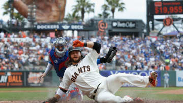 SAN FRANCISCO, CA - SEPTEMBER 29: Brandon Crawford #35 of the San Francisco Giants slides in safely at home plate to score on a single hit by Gorkys Hernandez #7 in the bottom of the second inning against the Los Angeles Dodgers at AT&T Park on September 29, 2018 in San Francisco, California. (Photo by Lachlan Cunningham/Getty Images)