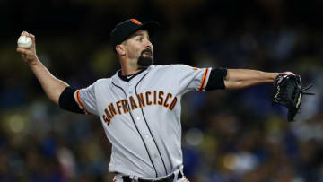 LOS ANGELES, CALIFORNIA - APRIL 02: Nick Vincent #61 of the San Francisco Giants delivers a pitch against the Los Angeles Dodgers during the seventh inning at Dodger Stadium on April 02, 2019 in Los Angeles, California. (Photo by Yong Teck Lim/Getty Images)