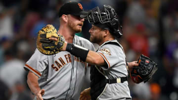 DENVER, CO - JULY 15: Stephen Vogt #21 of the San Francisco Giants celebrates a 2-1 win with Will Smith #13 of the San Francisco Giants before the bottom of the ninth inning during game two of a doubleheader against the Colorado Rockies at Coors Field on July 15, 2019 in Denver, Colorado. (Photo by Dustin Bradford/Getty Images)