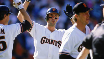 SAN FRANCISCO - 1989: Will Clark #22 of the San Francisco Giants high fives teammates during a game in the 1989 season at Candlestick Park in San Francisco, California. (Photo by Otto Greule Jr/Getty Images)