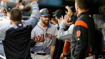 NEW YORK, NY - AUGUST 21: Evan Longoria #10 of the San Francisco Giants celebrates his first inning two run home run against the New York Mets in the dugout with his teammates at Citi Field on August 21, 2018 in the Flushing neighborhood of the Queens borough of New York City. (Photo by Jim McIsaac/Getty Images)