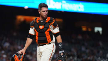 SAN FRANCISCO, CALIFORNIA - SEPTEMBER 24: Buster Posey #28 of the San Francisco Giants looks on during the game against the Colorado Rockies at Oracle Park on September 24, 2019 in San Francisco, California. (Photo by Daniel Shirey/Getty Images)