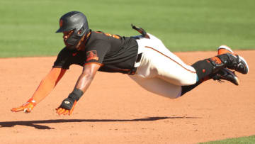 SCOTTSDALE, ARIZONA - MARCH 28: Heliot Ramos #80 of the SF Giants dives safely into second base in the eighth inning against the Oakland Athletics in an MLB spring training game at Scottsdale Stadium on March 28, 2021 in Scottsdale, Arizona. (Photo by Abbie Parr/Getty Images)