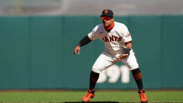 SAN FRANCISCO, CALIFORNIA - APRIL 11: Donovan Solano #7 of the SF Giants fields during the game against the Colorado Rockies at Oracle Park on April 11, 2021 in San Francisco, California. (Photo by Daniel Shirey/Getty Images)