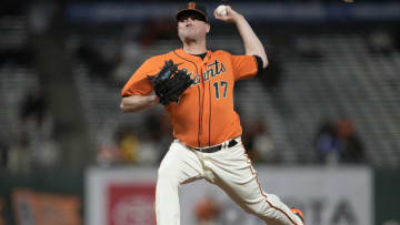 SAN FRANCISCO, CALIFORNIA - MAY 07: Jake McGee #17 of the SF Giants pitches against the San Diego Padres in the ninth inning at Oracle Park on May 07, 2021 in San Francisco, California. (Photo by Thearon W. Henderson/Getty Images)