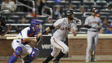 NEW YORK, NEW YORK - AUGUST 24: Brandon Belt #9 of the San Francisco Giants follows through on an eighth inning RBI infield single against the New York Mets at Citi Field on August 24, 2021 in New York City. (Photo by Jim McIsaac/Getty Images)