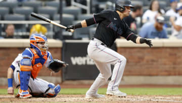 NEW YORK, NEW YORK - SEPTEMBER 28: Joe Panik #12 of the Miami Marlins singles during the fourth inning against the New York Mets at Citi Field on September 28, 2021 in New York City. The Mets defeated the Marlins 5-2. (Photo by Jim McIsaac/Getty Images)