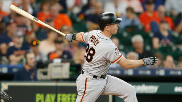 HOUSTON, TX - MAY 23: Buster Posey #28 of the San Francisco Giants doubles in the sixth inning against the Houston Astros at Minute Maid Park on May 23, 2018 in Houston, Texas. (Photo by Bob Levey/Getty Images)
