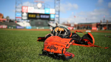 SAN FRANCISCO, CA - MAY 19: A Rawlings glove is placed on the infield grass before competition between the San Francisco Giants and the visiting Los Angeles Dodgers at AT