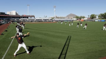 SCOTTSDALE, AZ - MARCH 10: Matt Cain #18 of the San Francisco Giants and teammates warm up before the spring training game against the Cleveland Indians at Scottsdale Stadium on March 10, 2017 in Scottsdale, Arizona. (Photo by Tim Warner/Getty Images)