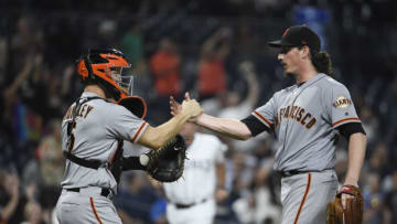 SAN DIEGO, CA - AUGUST 28: Jeff Samardzija #29 of the San Francisco Giants, right, is congratulated by Nick Hundley #5 after getting the final out in a baseball game against the San Diego Padres at PETCO Park on August 28, 2017 in San Diego, California. The Giants won 3-0. (Photo by Denis Poroy/Getty Images)