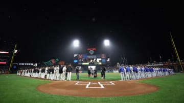 SAN FRANCISCO, CA - SEPTEMBER 11: The San Francisco Giants and the Los Angeles Dodgers stand for the National Anthem before their game at AT&T Park on September 11, 2017 in San Francisco, California. (Photo by Ezra Shaw/Getty Images)