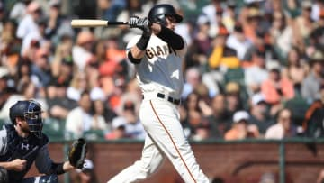 SAN FRANCISCO, CA - OCTOBER 01: Jarrett Parker #6 of the San Francisco Giants hits an rbi single scoring Buster Posey #28 against the San Diego Padres in the bottom of the fourth inning at AT&T Park on October 1, 2017 in San Francisco, California. (Photo by Thearon W. Henderson/Getty Images)
