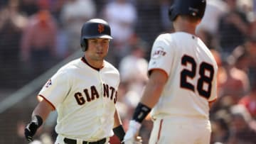 SAN FRANCISCO, CA - APRIL 03: Joe Panik #12 of the San Francisco Giants is congratulated by Buster Posey #28 after he hit a home run in the fourth inning against the Seattle Mariners at AT&T Park on April 3, 2018 in San Francisco, California. (Photo by Ezra Shaw/Getty Images)