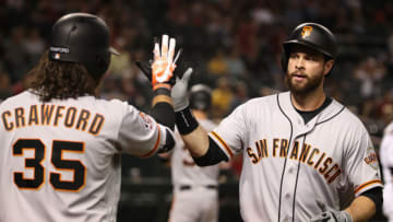 PHOENIX, AZ - APRIL 18: Brandon Belt #9 of the San Francisco Giants high fives Brandon Crawford #35 after hitting a two-run home run against the Arizona Diamondbacks during the 10th inning of the MLB game at Chase Field on April 18, 2018 in Phoenix, Arizona. (Photo by Christian Petersen/Getty Images)