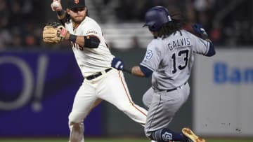 SAN FRANCISCO, CA - MAY 01: Brandon Crawford #35 of the San Francisco Giants to complete the double-pay looks to get his throw off over the top of Freddy Galvis #13 of the San Diego Padres in the top of the fifth inning at AT&T Park on May 1, 2018 in San Francisco, California. (Photo by Thearon W. Henderson/Getty Images)