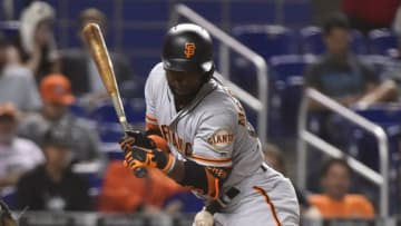 MIAMI, FL - JUNE 11: Andrew McCutchen #22 of the San Francisco Giants is hit by a pitch during the seventh inning against the Miami Marlins at Marlins Park on June 11, 2018 in Miami, Florida. (Photo by Eric Espada/Getty Images)