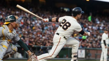 SAN FRANCISCO, CA - AUGUST 03: Buster Posey #28 of the San Francisco Giants hits an RBI single against the Oakland Athletics during the first inning at AT&T Park on August 3, 2017 in San Francisco, California. (Photo by Jason O. Watson/Getty Images)