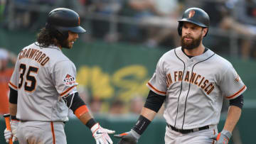 SF Giants shortstop Brandon Crawford (left) and first baseman Brandon Belt (right). (Photo by Thearon W. Henderson/Getty Images)
