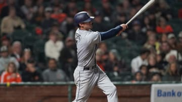 SAN FRANCISCO, CA - SEPTEMBER 26: Wil Myers #4 of the San Diego Padres hits a sacrifice fly scoring Freddy Galvis #13 against the San Francisco Giants in the top of the third inning at AT&T Park on September 26, 2018 in San Francisco, California. (Photo by Thearon W. Henderson/Getty Images)