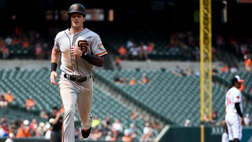 BALTIMORE, MD - JUNE 02: Mike Yastrzemski #5 of the San Francisco Giants scores from a Pablo Sandoval #48 sacrifice fly during the seventh inning against the Baltimore Orioles at Oriole Park at Camden Yards on June 2, 2019 in Baltimore, Maryland. (Photo by Will Newton/Getty Images)