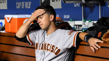 LOS ANGELES, CA - JUNE 19: Buster Posey #28 of the San Francisco Giants sits in the dugout in the fifth inning of the game against the Los Angeles Dodgers at Dodger Stadium on June 19, 2019 in Los Angeles, California. (Photo by Jayne Kamin-Oncea/Getty Images)