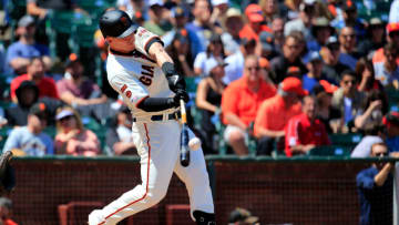 SAN FRANCISCO, CALIFORNIA - MAY 23: Tyler Austin #19 of the San Francisco Giants hits a solo home run during the seventh inning against the Atlanta Braves at Oracle Park on May 23, 2019 in San Francisco, California. (Photo by Daniel Shirey/Getty Images)