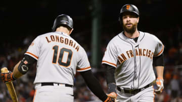 Brandon Belt celebrates with SF Giants teammate Evan Longoria. (Photo by Kathryn Riley/Getty Images)