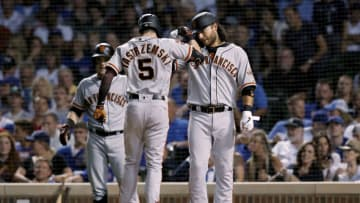 CHICAGO, ILLINOIS - AUGUST 21: Mike Yastrzemski #5 and Brandon Crawford #35 of the San Francisco Giants celebrate after Yastrzemski hit a home run in the sixth inning against the Chicago Cubs at Wrigley Field on August 21, 2019 in Chicago, Illinois. (Photo by Dylan Buell/Getty Images)