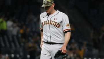 PITTSBURGH, PA - MAY 15: Jake McGee #17 of the San Francisco Giants walks off the field after giving up a home run in the ninth inning against the Pittsburgh Pirates at PNC Park on May 15, 2021 in Pittsburgh, Pennsylvania. (Photo by Justin K. Aller/Getty Images)