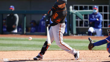 SURPRISE, ARIZONA - MARCH 01: Tommy La Stella #18 of the SF Giants hits a double against the Texas Rangers during the third inning of the MLB spring training game on March 01, 2021 in Surprise, Arizona. (Photo by Christian Petersen/Getty Images)