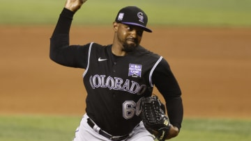 MIAMI, FLORIDA - JUNE 09: Mychal Givens #60 of the Colorado Rockies delivers a pitch during the seventh inning against the Miami Marlins at loanDepot park on June 09, 2021 in Miami, Florida. (Photo by Michael Reaves/Getty Images)