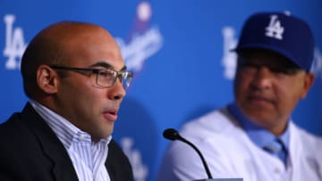 LOS ANGELES, CA - DECEMBER 01: Farhan Zaidi, Los Angeles Dodgers general manager, left, speaks as Dave Roberts, right, looks on during a press conference to introduce Roberts as the new Los Angeles Dodgers manager at Dodger Stadium on December 1, 2015 in Los Angeles, California. (Photo by Victor Decolongon/Getty Images)