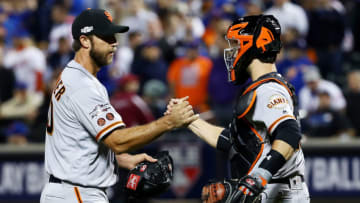 NEW YORK, NY - OCTOBER 05: Madison Bumgarner #40 and Buster Posey #28 of the San Francisco Giants celebrate their 3-0 win over the New York Mets during their National League Wild Card game at Citi Field on October 5, 2016 in New York City. (Photo by Al Bello/Getty Images)
