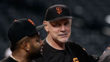 PHOENIX, AZ - SEPTEMBER 25: Manager Bruce Bochy #15 of the San Francisco Giants (R) talks with Pablo Sandoval #48 of the Giants before the start of a MLB game against the Arizona Diamondbacks at Chase Field on September 25, 2017 in Phoenix, Arizona. The Giants defeated the Diamondbacks 9-2. (Photo by Ralph Freso/Getty Images)