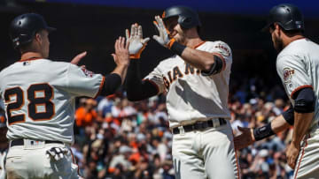SAN FRANCISCO, CA - APRIL 29: Evan Longoria #10 of the San Francisco Giants is congratulated by Buster Posey #28 and Brandon Belt #9 after hitting a three-run home run against the Los Angeles Dodgers during the first inning at AT&T Park on April 29, 2018 in San Francisco, California. (Photo by Jason O. Watson/Getty Images)